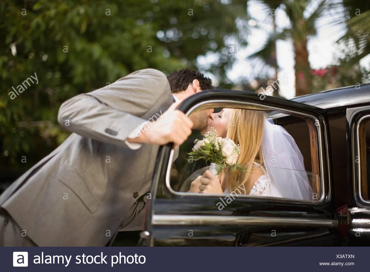Kissing bridal couple - Stock Image