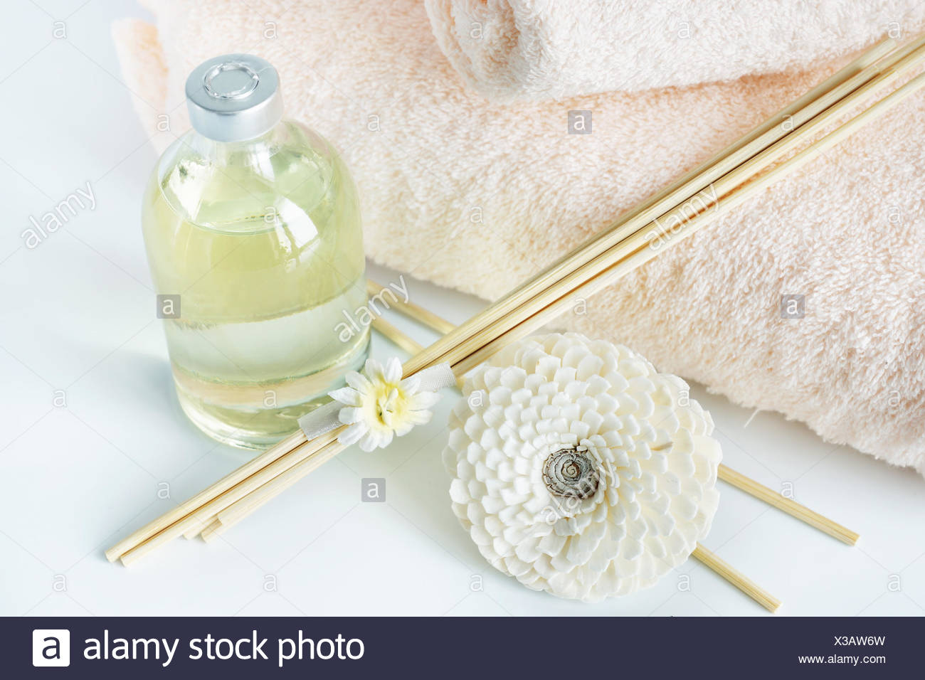 Sandal oil and sticks for spa procedures - Stock Image
