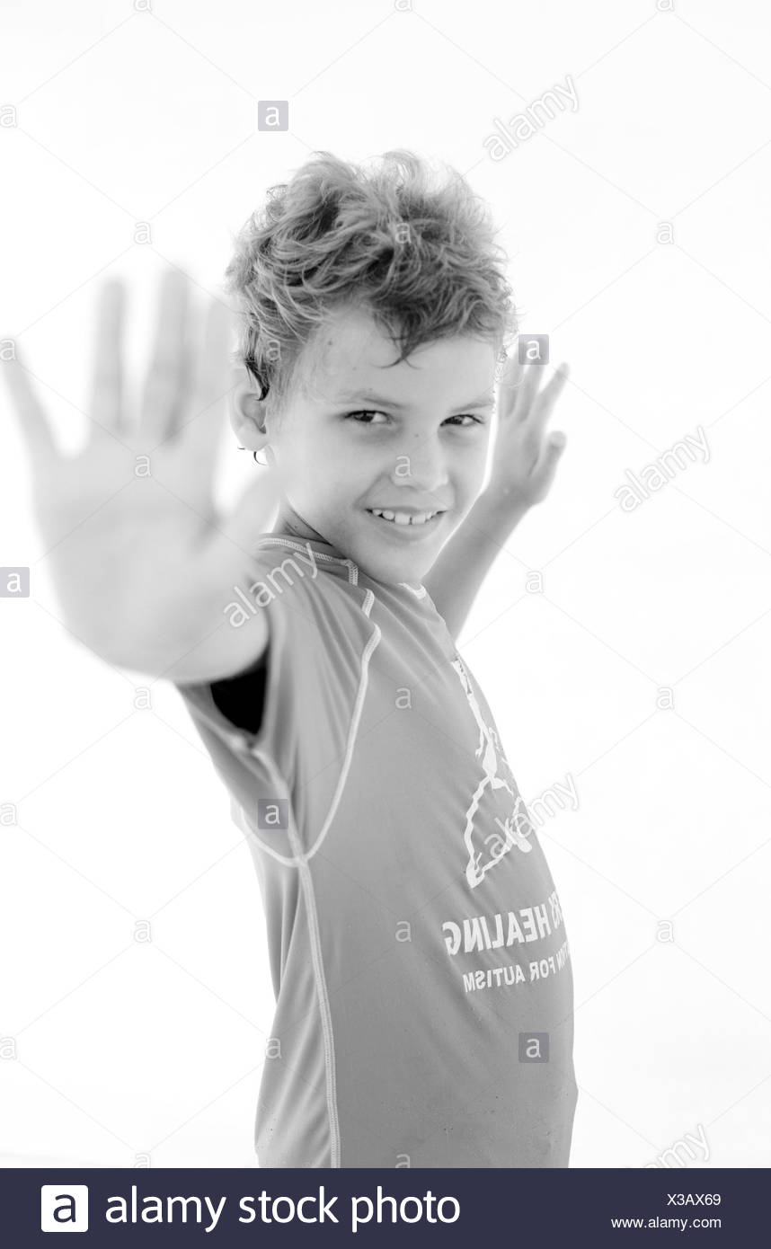 Portrait of child participant in Surfer's Healing, a camp for children with autism held in Wrightsville Beach, NC. - Stock Image