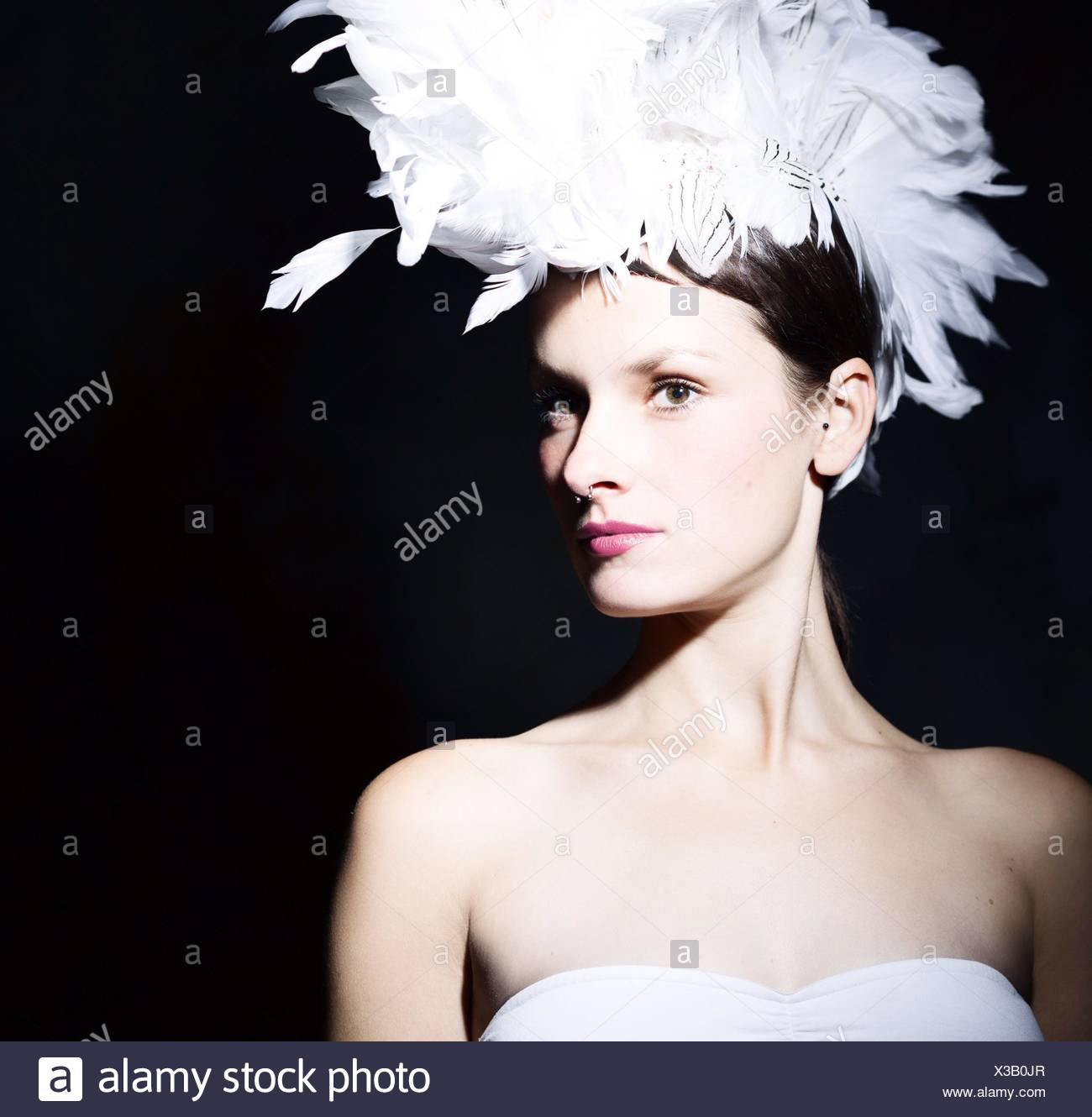 Portrait Of A Beautiful Young Woman Over Black Background - Stock Image