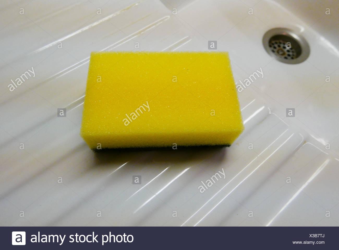 Close-Up Of Sponge Scrub In Sink - Stock Image