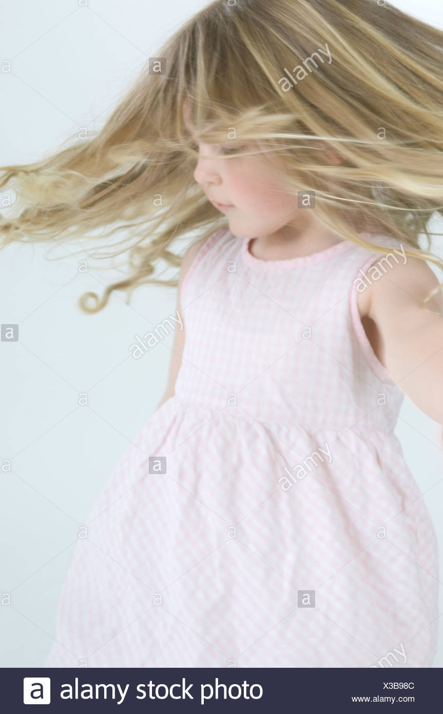 portrait of little girl dancing - Stock Image
