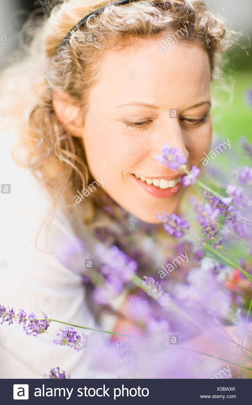 portrait of middle-aged woman and flower - Stock Image