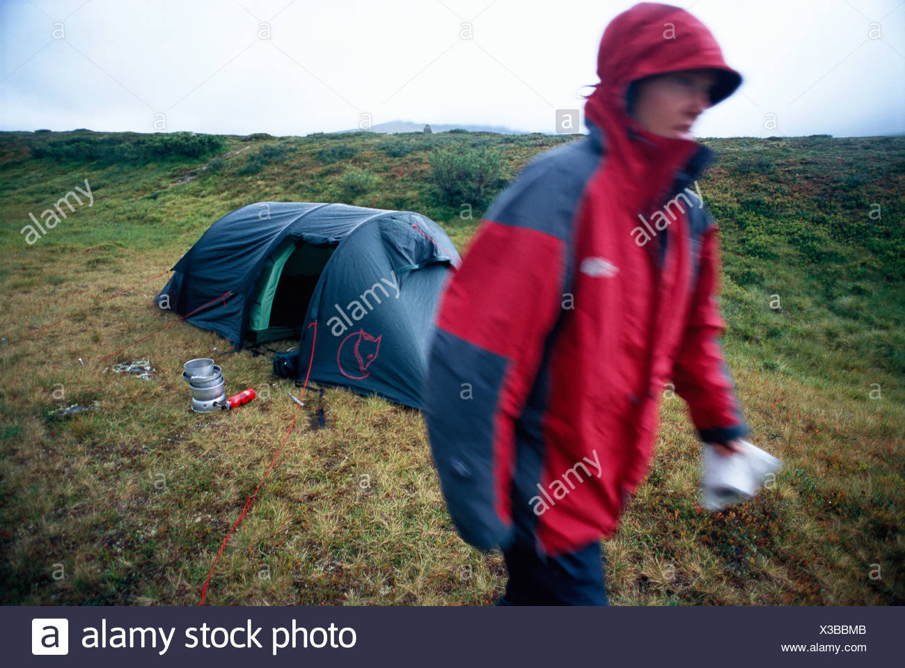 Woman camping. - Stock Image