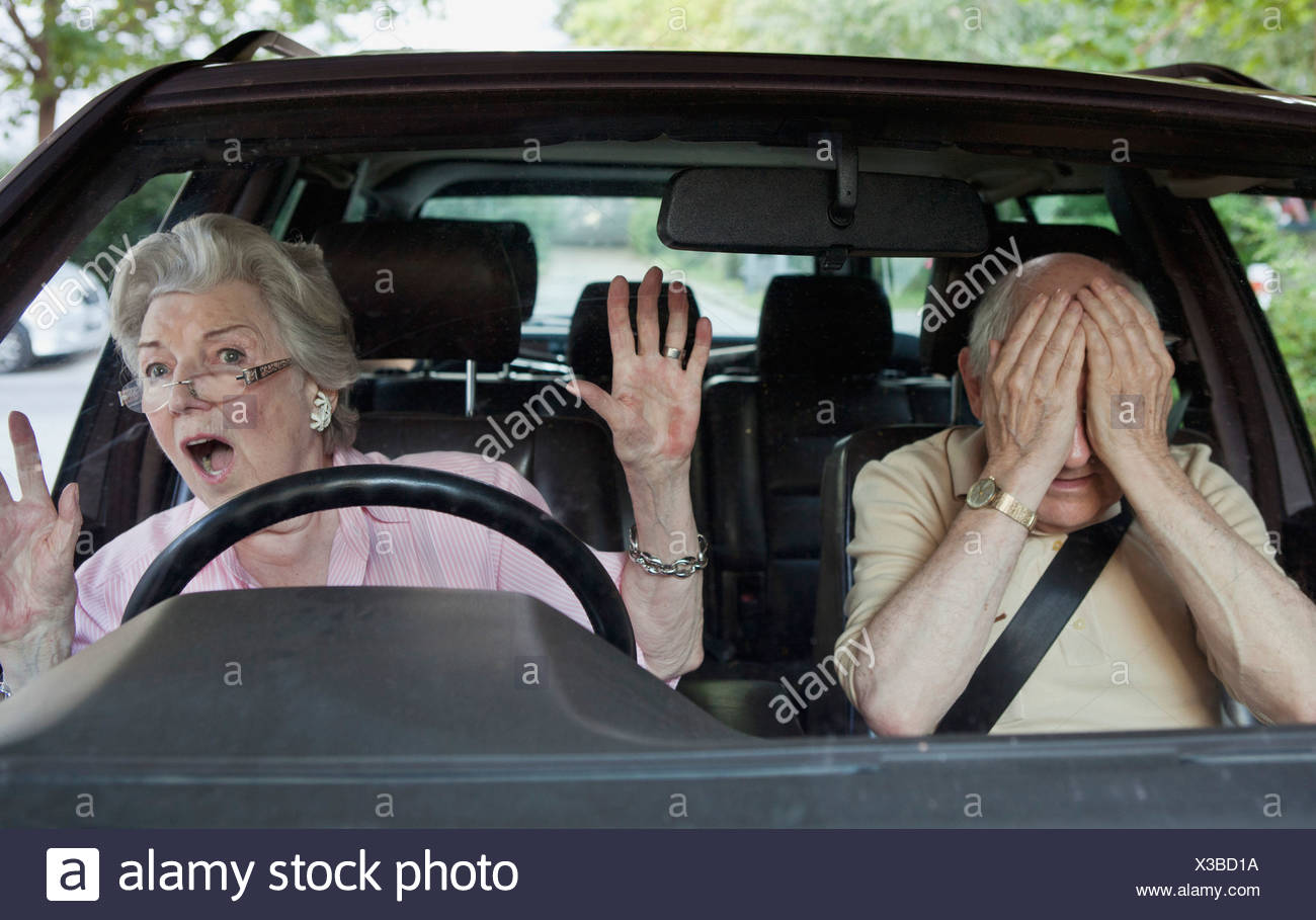 Senior woman having trouble learning to drive - Stock Image