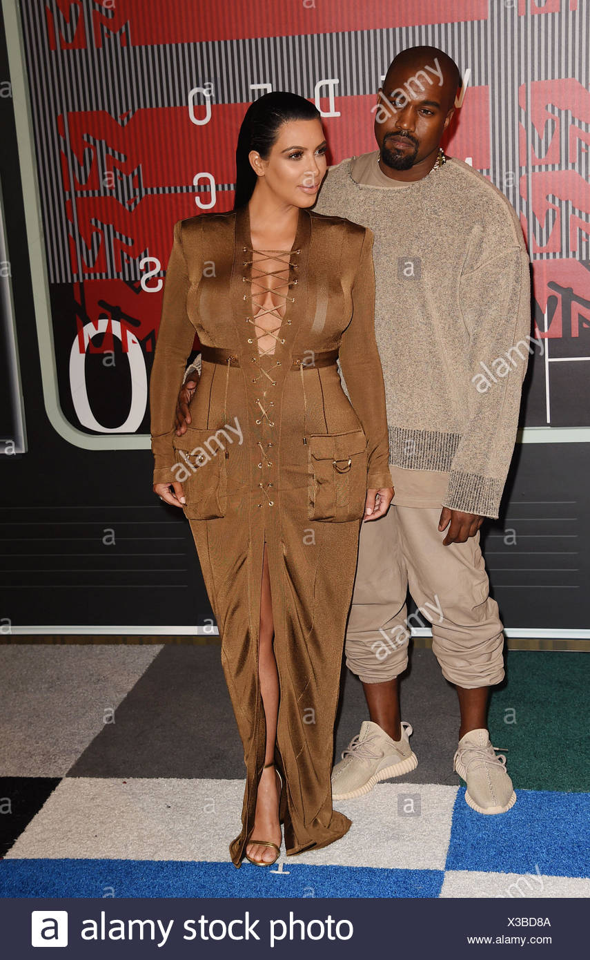 Rapper Kanye West and TV personality Kim Kardashian arrive at the 2015 MTV Video Music Awards at Microsoft Theater on August 30, 2015 in Los Angeles, California., Additional-Rights-Clearances-NA - Stock Image