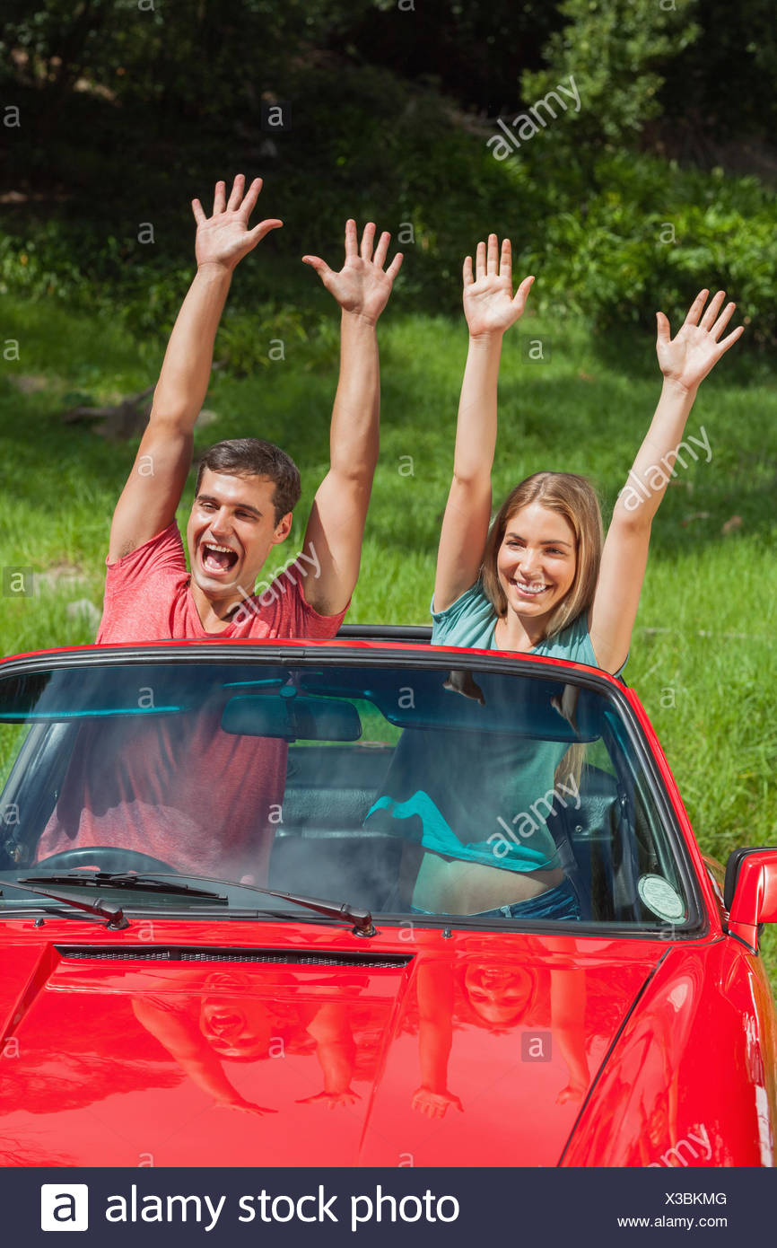 Crazy couple having fun in their cabriolet - Stock Image