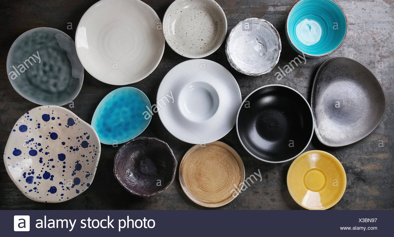 Empty Colorful Modern Ceramic Plates And Bowls Collection Various Of Dishware Over Dark Metal Background Top View Stock Photo Alamy