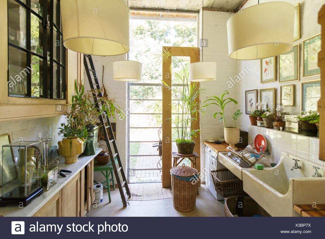 Glass door in rustic kitchen - Stock Image