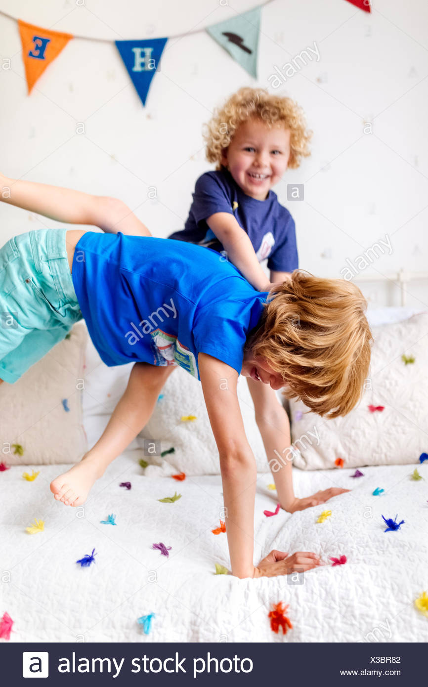Little boy playing with his big brother at home - Stock Image