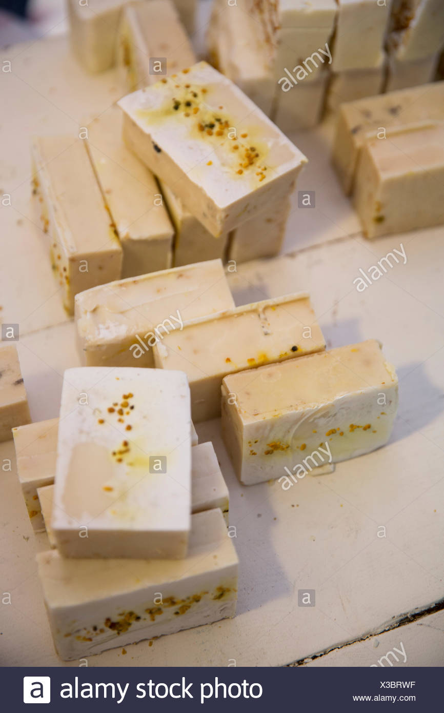 Soap bars on handmade soap workshop table - Stock Image