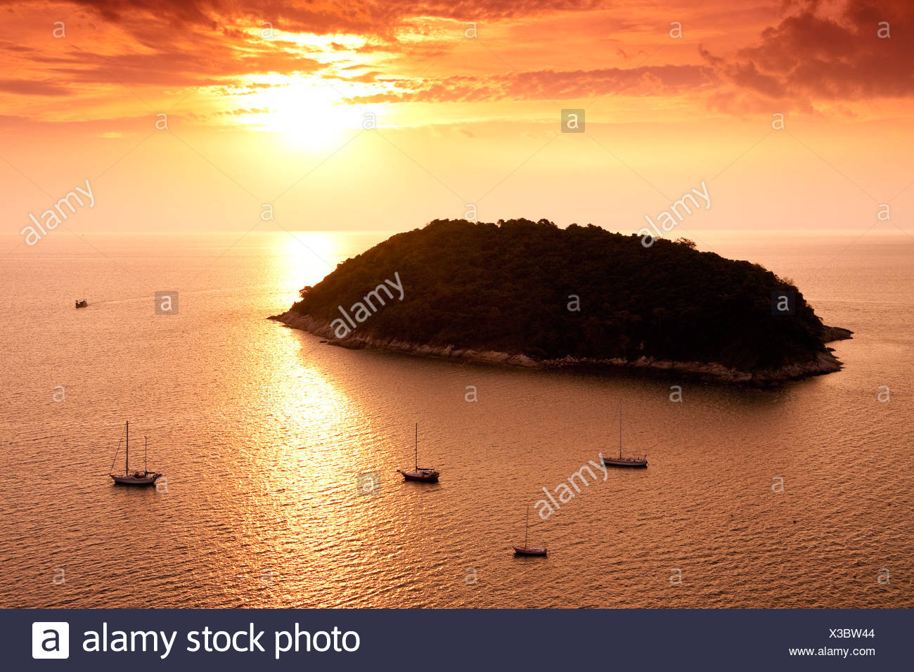 View of the off-shore Ko Man Island shortly before sunset Phuket Island Southern Thailand Southeast Asia - Stock Image