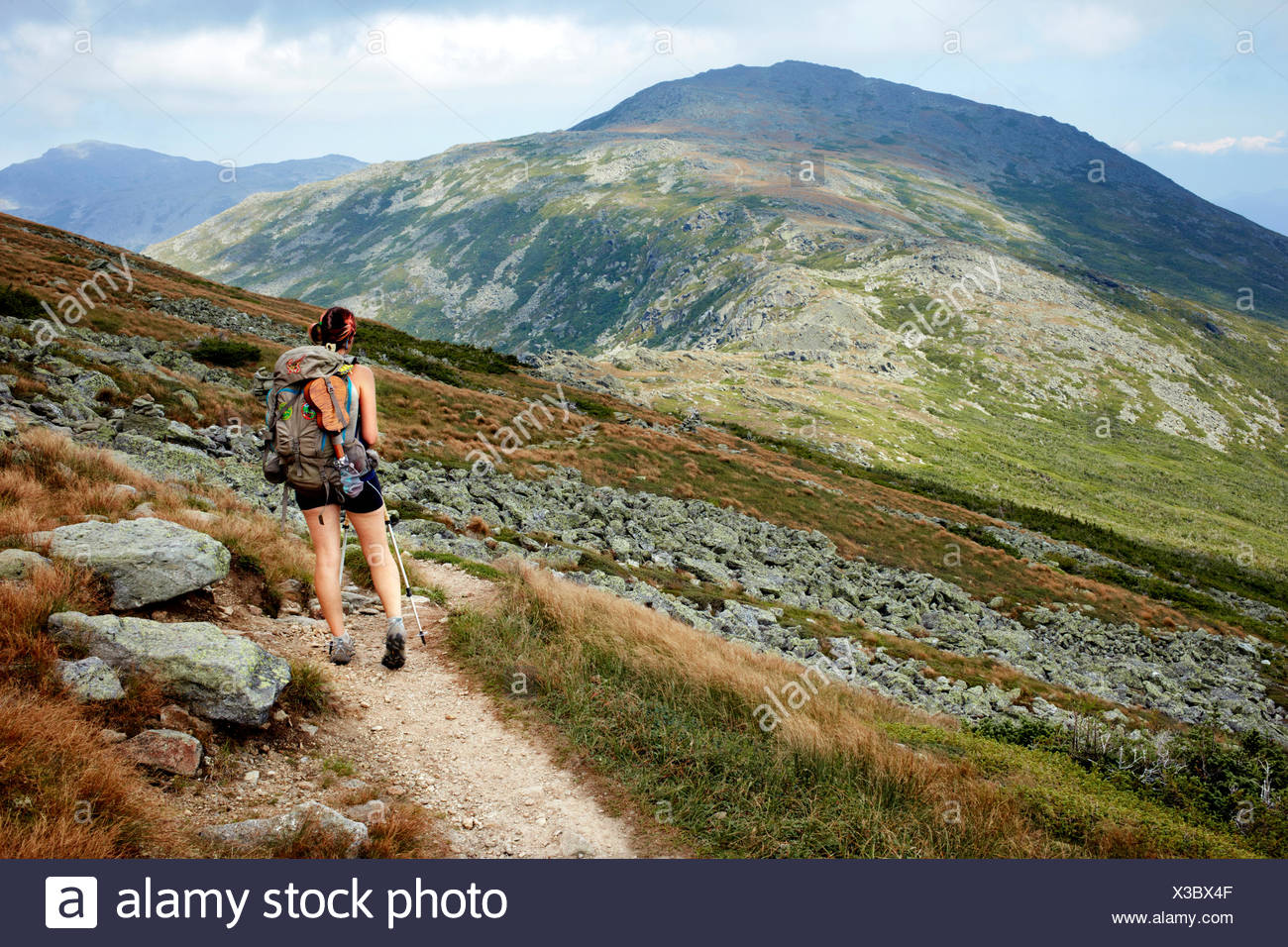 A hiker on the Appalachian Trail in the White Mountains. - Stock Image