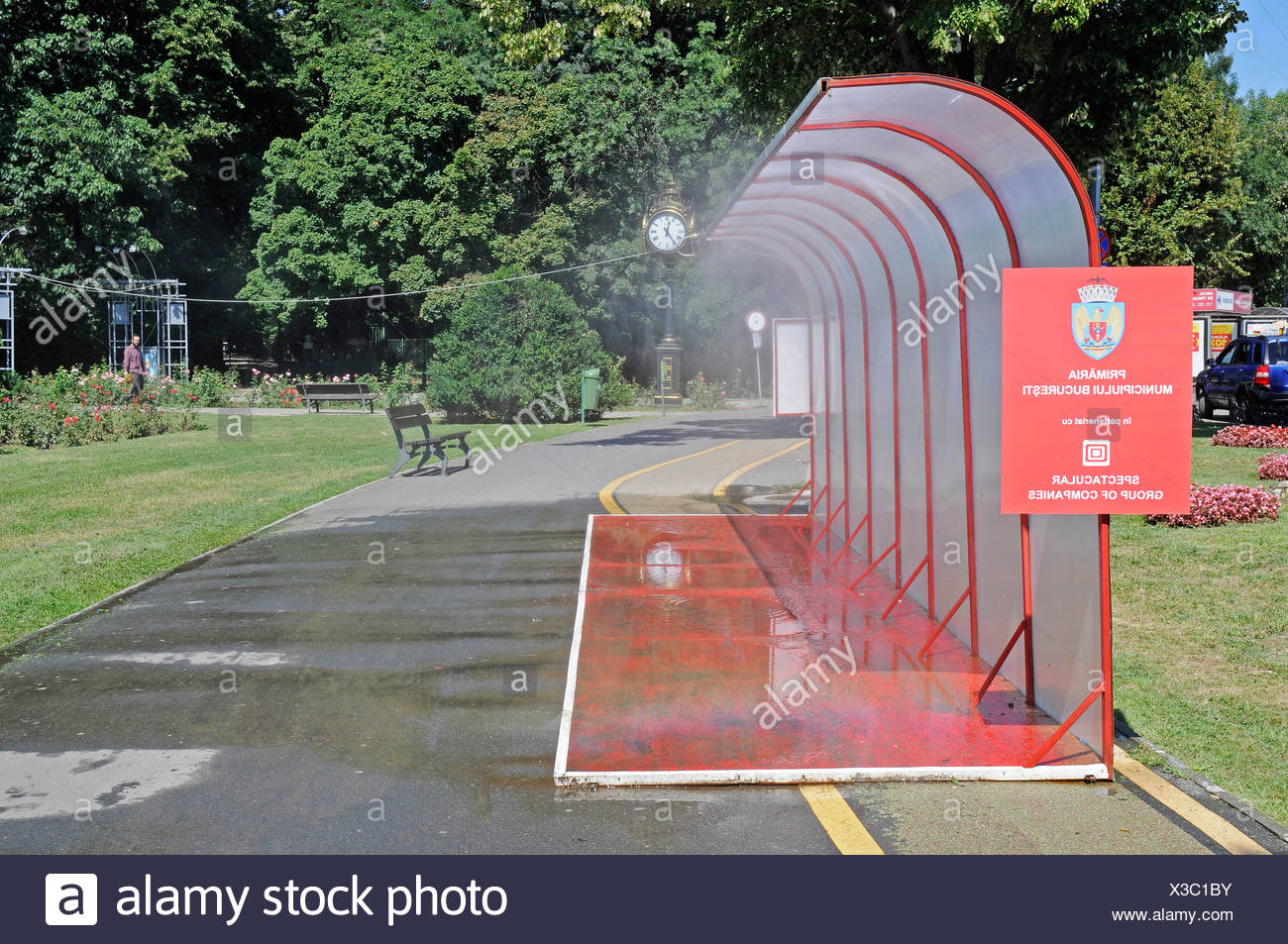 Public water sprinkling system, hot weather, water, cooling, summer, Bucharest, Romania, Eastern Europe, Europe, PublicGround - Stock Image