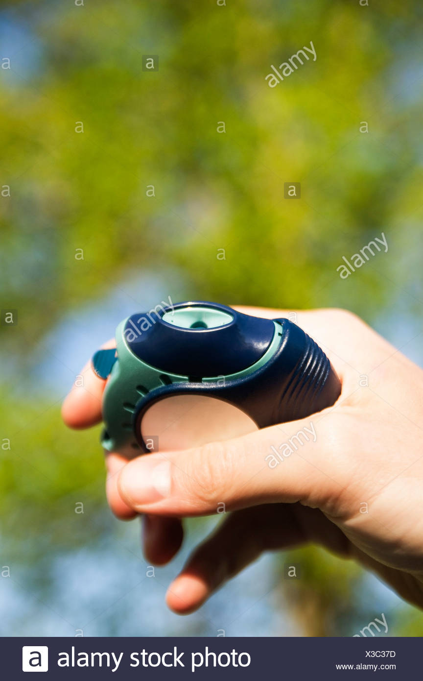 Hand holding asthmatic medicine - Stock Image