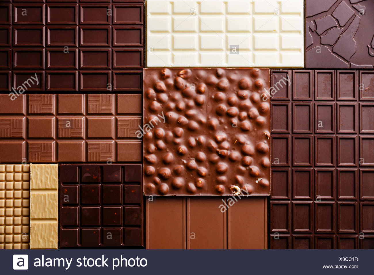 Chocolate bar assortment pattern background wallpaper - Stock Image