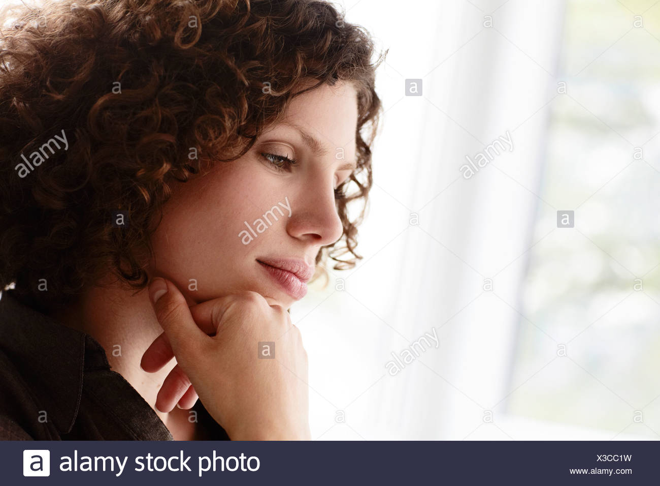 portrait of concentrated young businesswoman - Stock Image