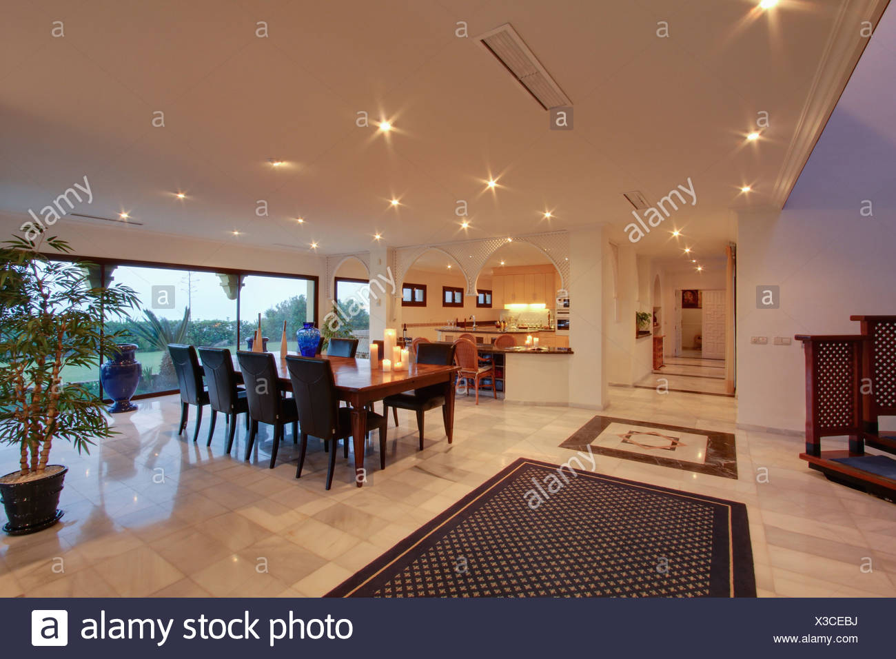 Upholstered Chairs And Rectangular Dining Table In Large Open Plan