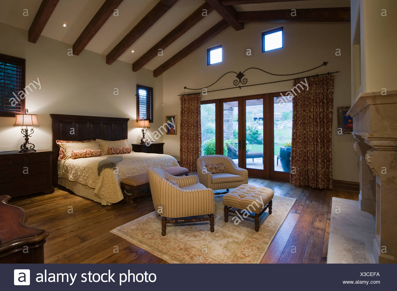 Seating area in beamed Palm Springs bedroom Stock Photo ...