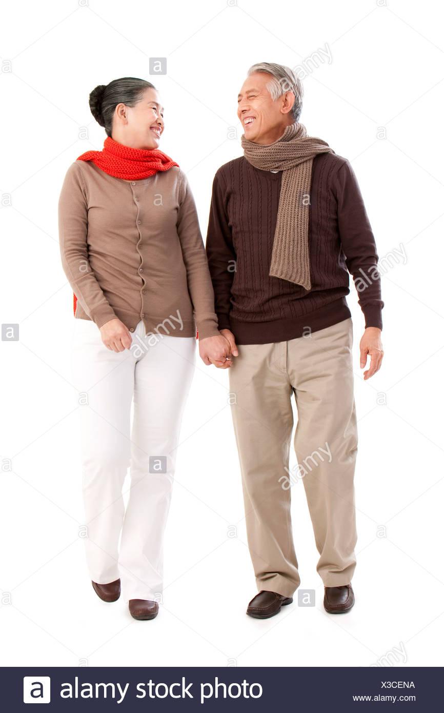 Senior affectionate couple holding hands - Stock Image
