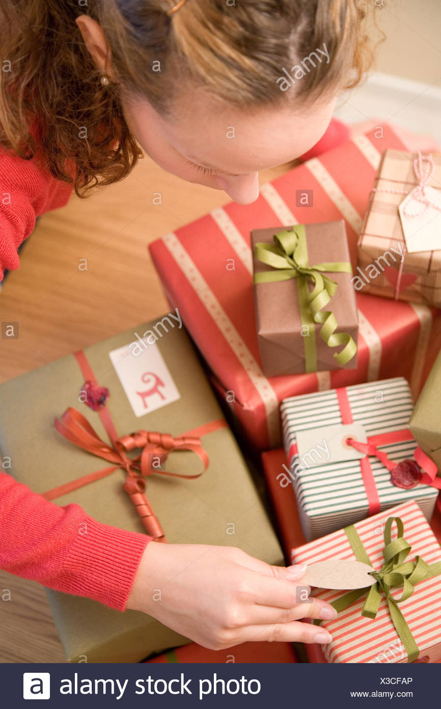 Woman with Christmas presents - Stock Image