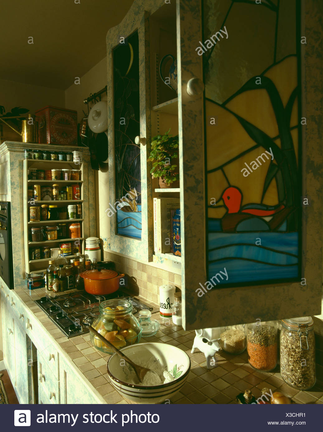 Close Up Of Stained Glass Cupboard Door Above Worktop With Food Preparation In Eighties Kitchen Stock Photo Alamy