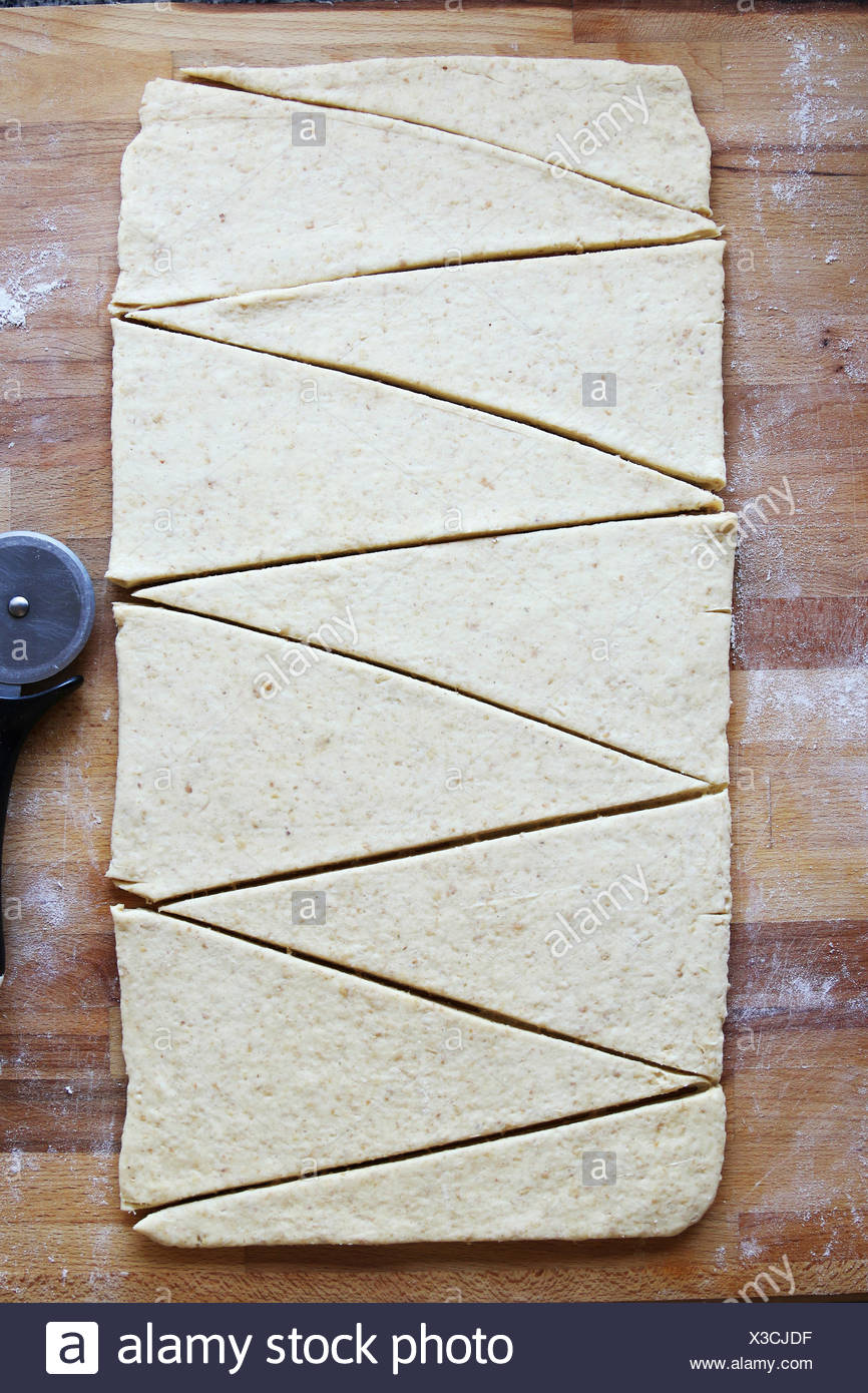 Close up with sliced whole wheat french croissants triangles.Top view - Stock Image
