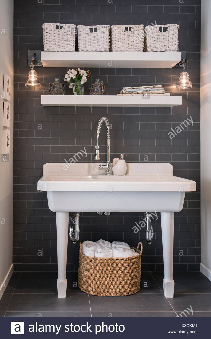 Wide white sink in bathroom - Stock Image