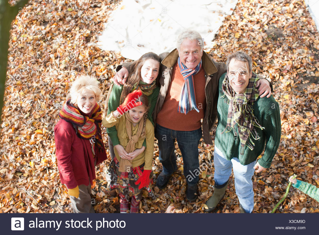Extended family playing in park - Stock Image