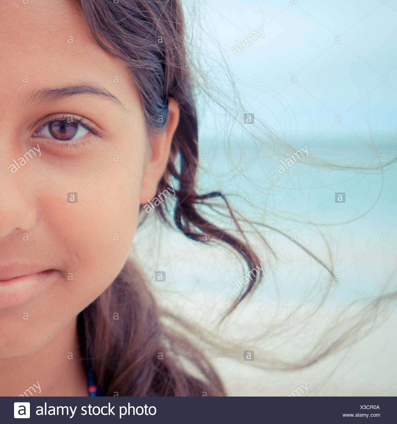 Portrait of a young girl on beach, Antigua, Caribbean - Stock Image