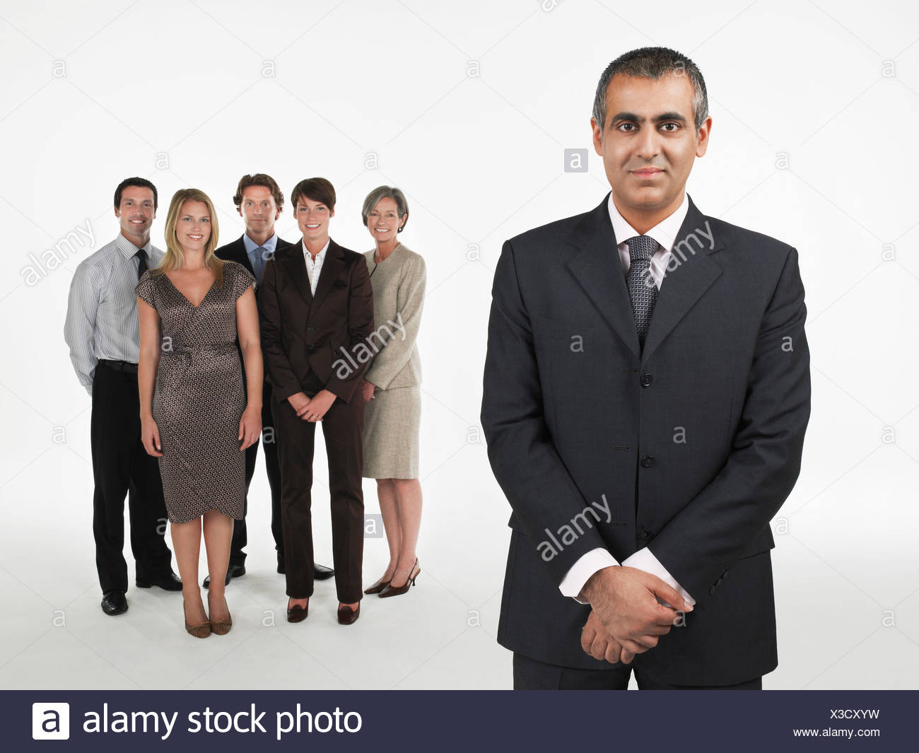 Proud Businessman, group behind - Stock Image