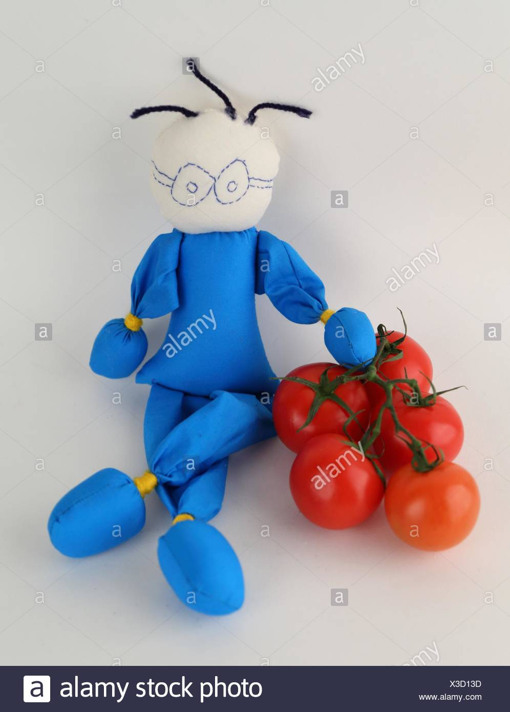 Puppet laying next to some tomatoes Stock Photo: 277496113 - Alamy