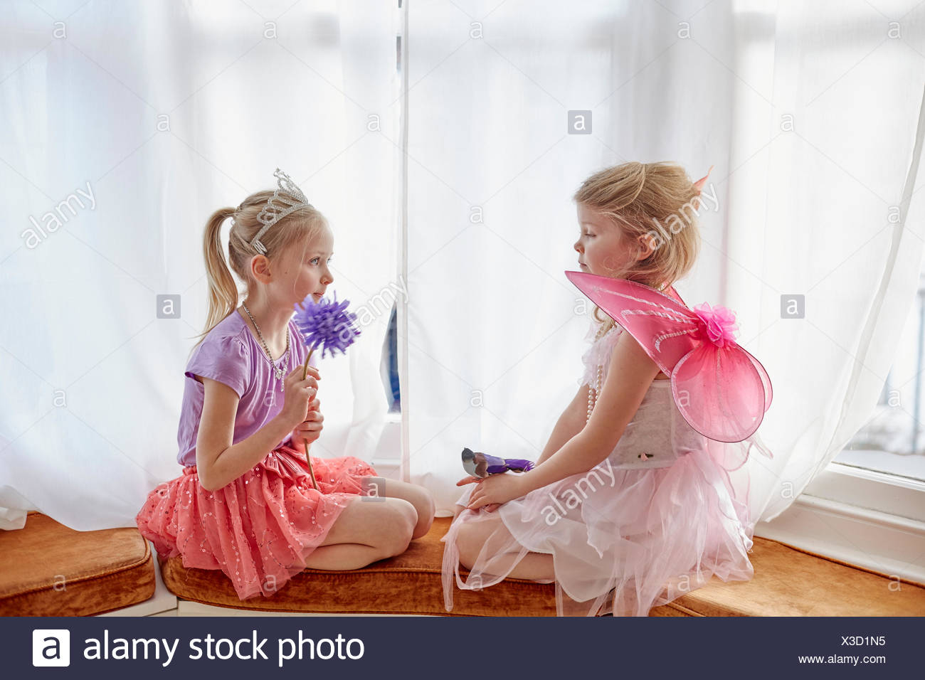 Two young girls in fancy dress sitting face to face - Stock Image & Girls In Fancy Dress Stock Photos u0026 Girls In Fancy Dress Stock ...