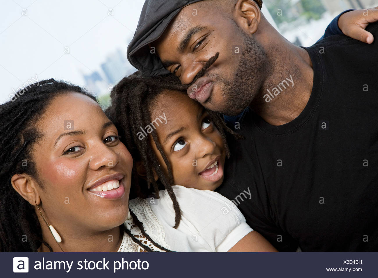 Two parents and their son goofing around Stock Photo