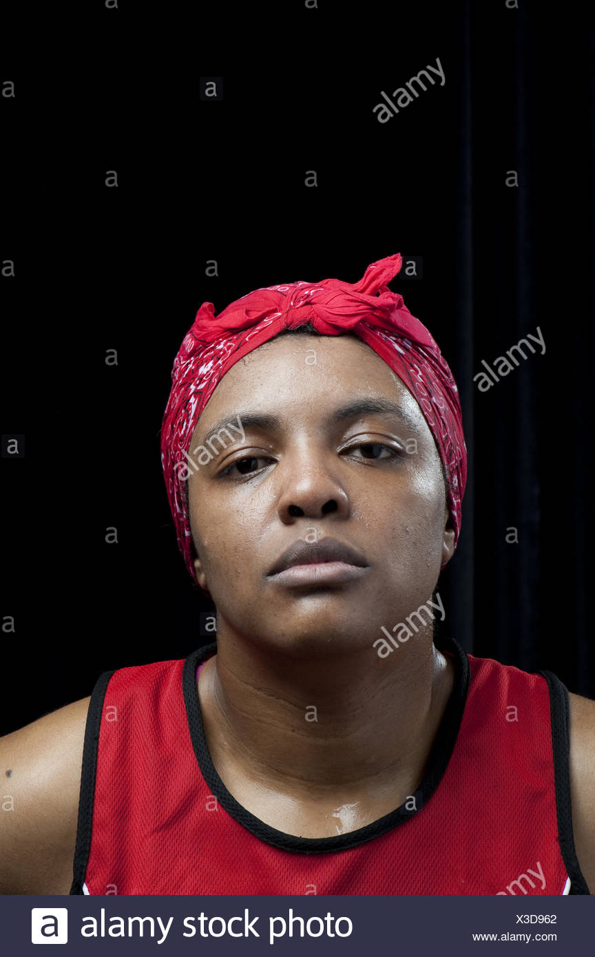 A female boxer wearing a headband stares deadpan after winning her semi-final round stands in a portrait at the Canadian Amatuer Boxing Championships in Saint-Hyacinthe, Quebec. - Stock Image