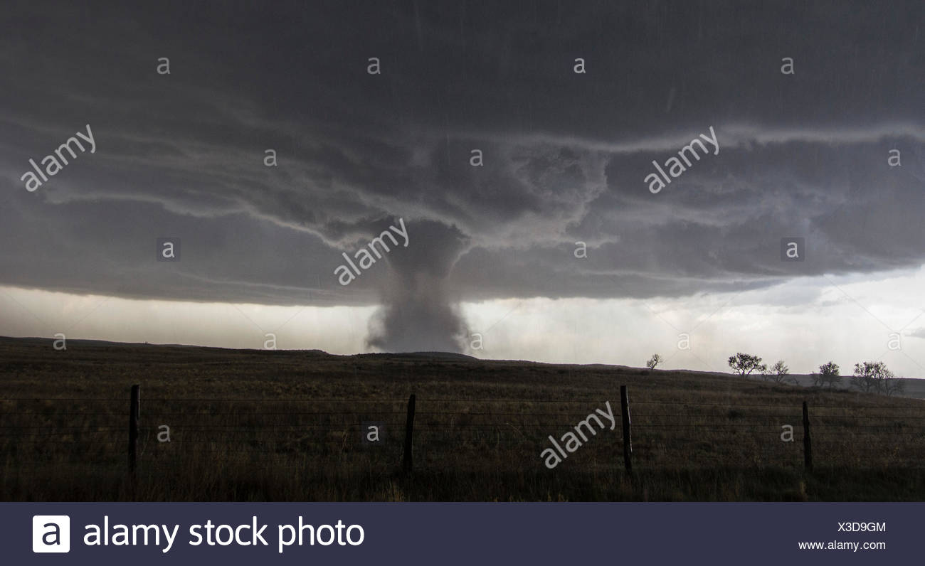 A multivortex tornado rotates over the open plains Stock Photo