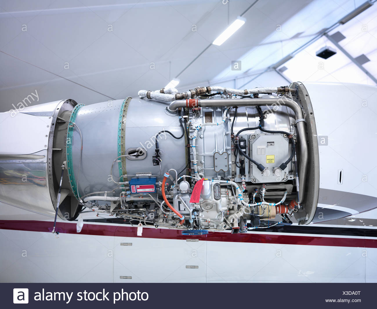 Jet engine in an aircraft hangar - Stock Image