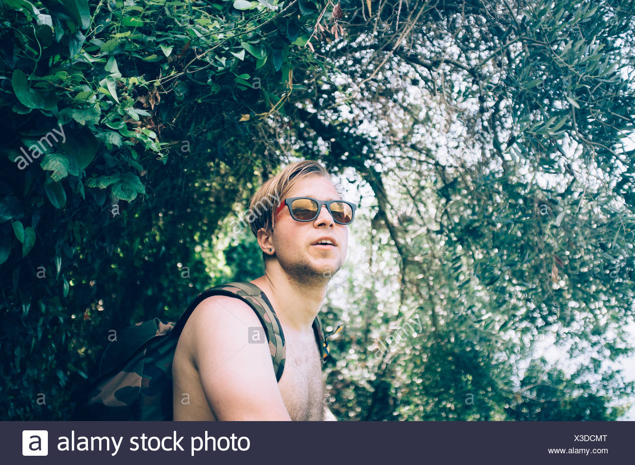 Portrait Of Young Man Under Tree - Stock Image