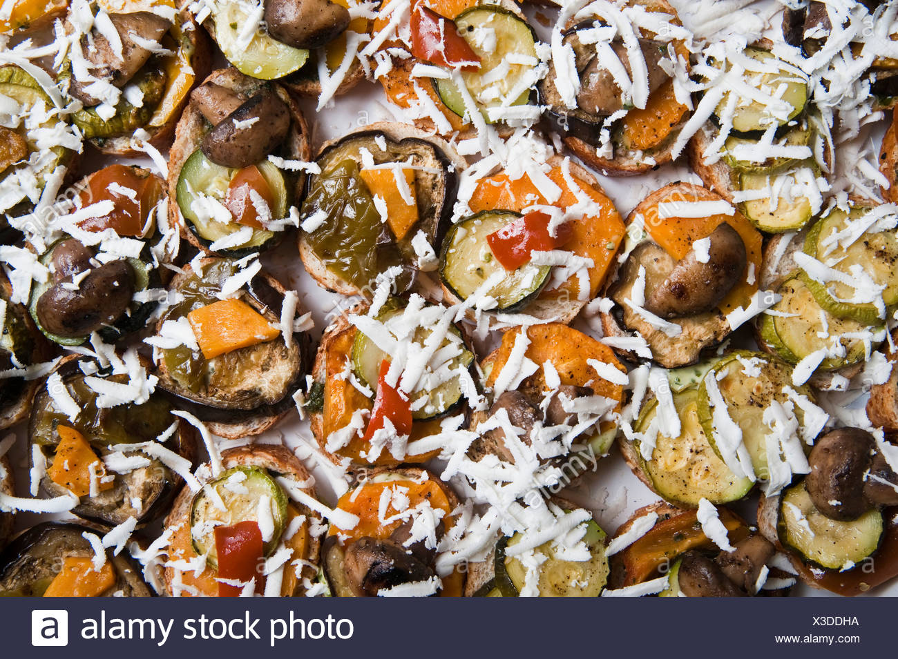 A plate of Antipasto grilled vegetables garnishes with cheese - Stock Image