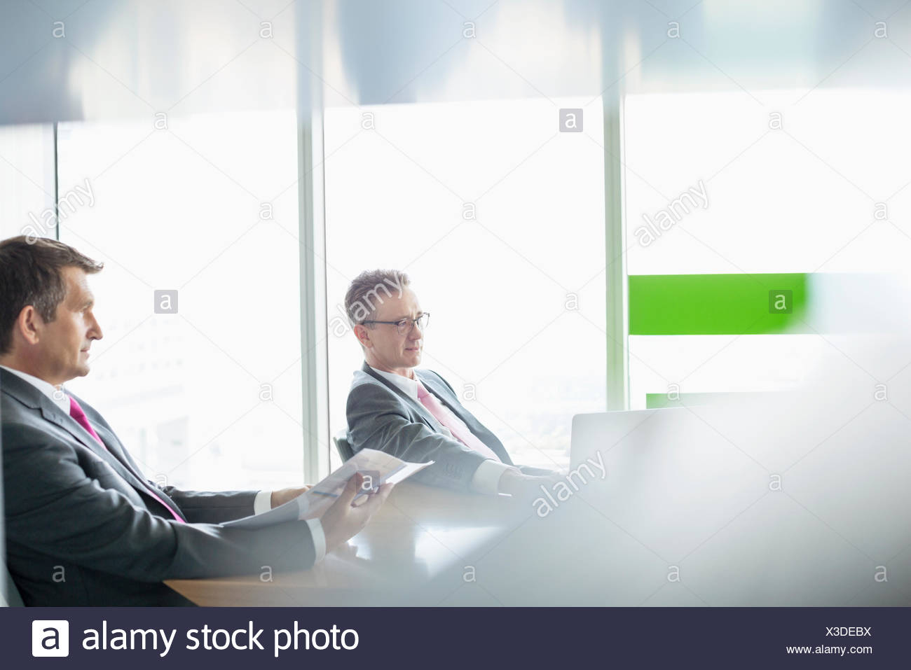 Businessmen working in office - Stock Image