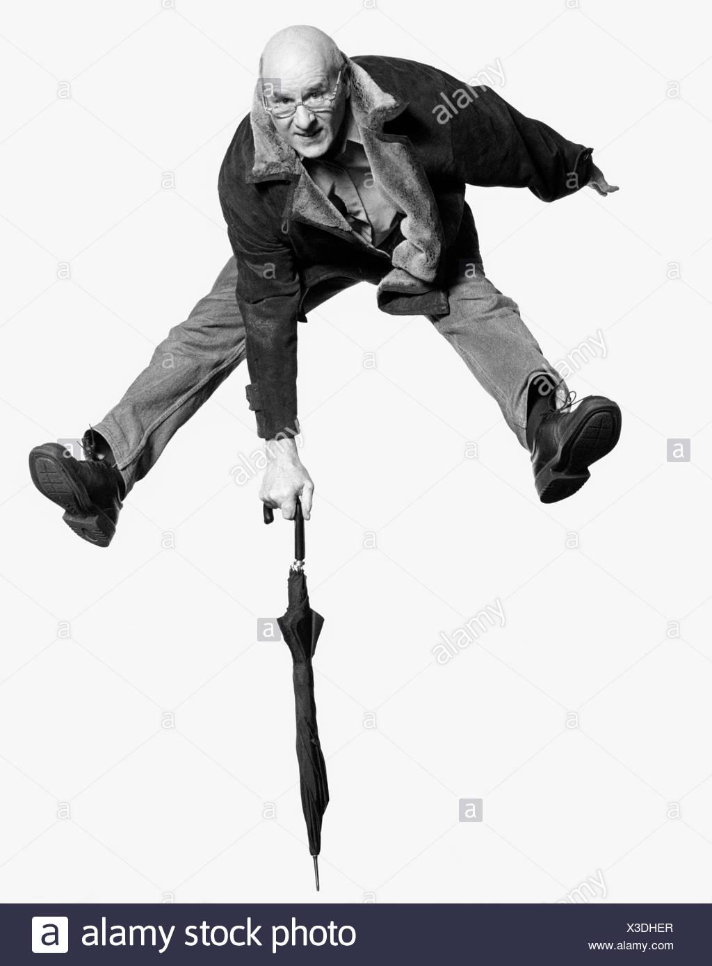 An elderly man in awkward pose - Stock Image