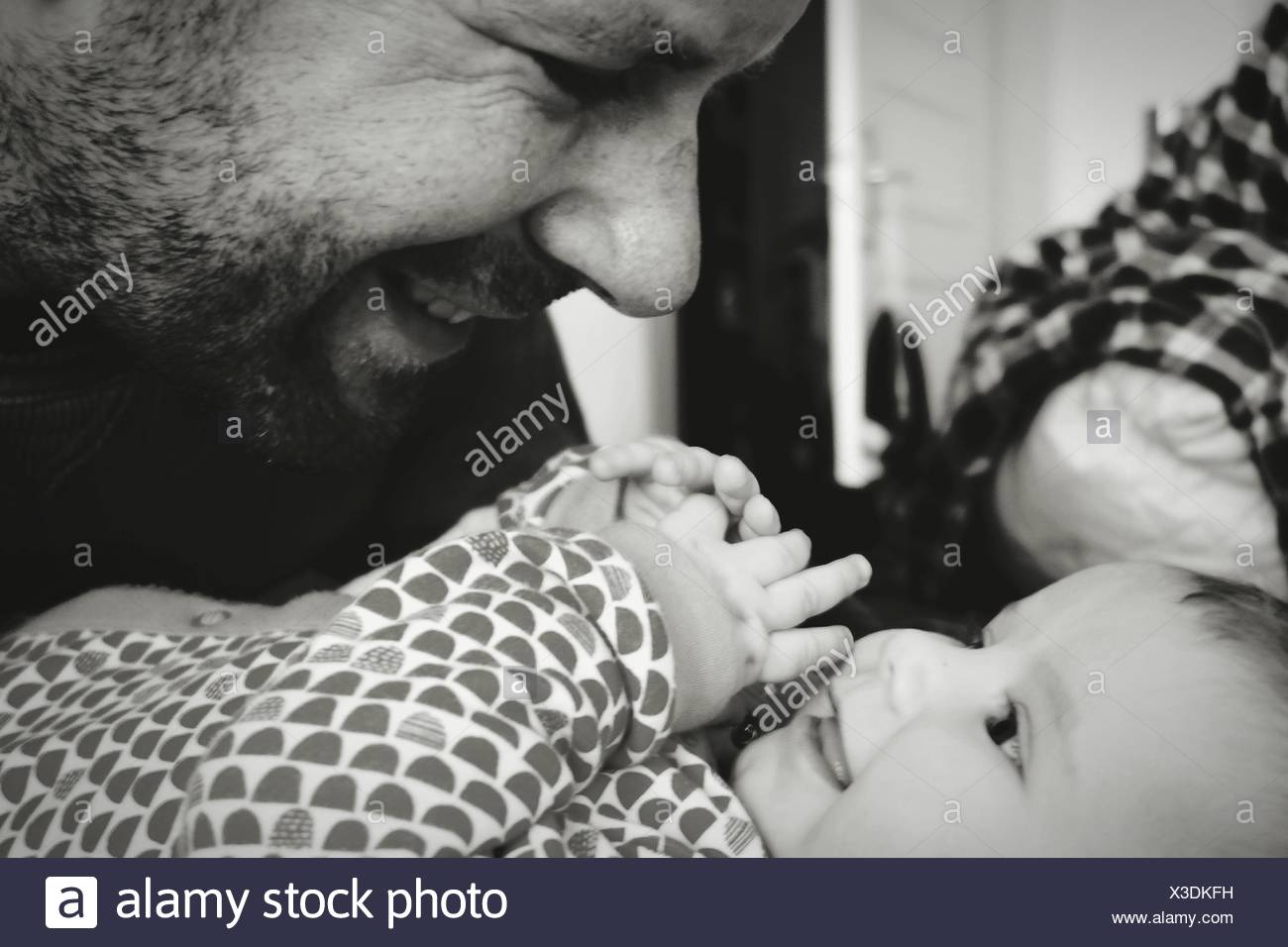 Close-Up Of Baby Girl And Father At Home - Stock Image