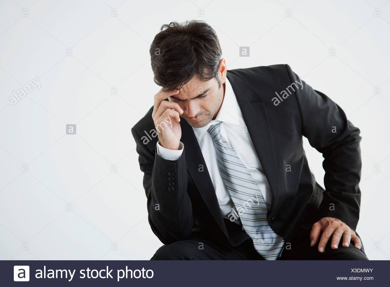 Businessman deep in thought facing difficulty - Stock Image