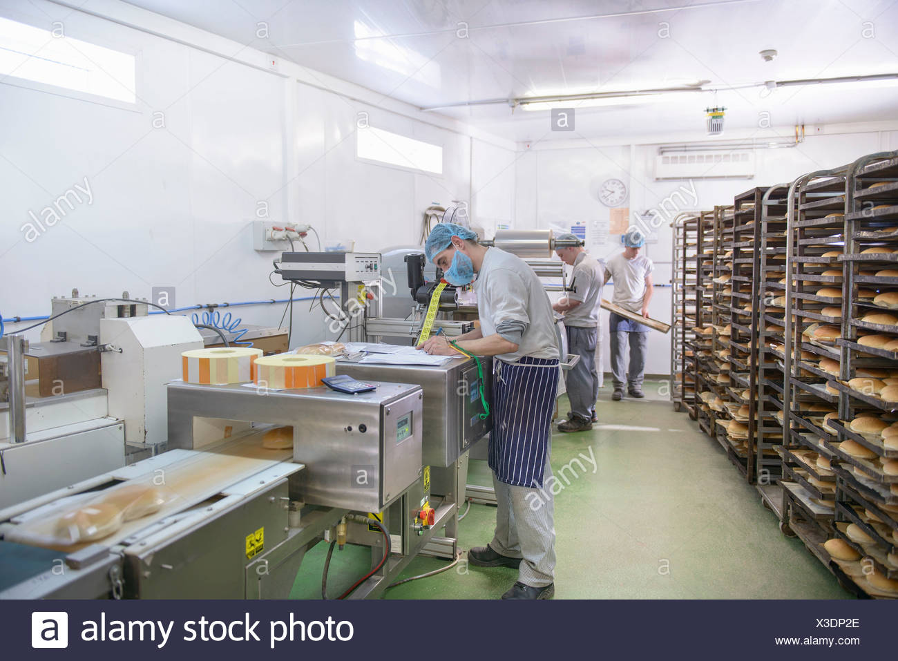Bread packing production line in small bakery - Stock Image