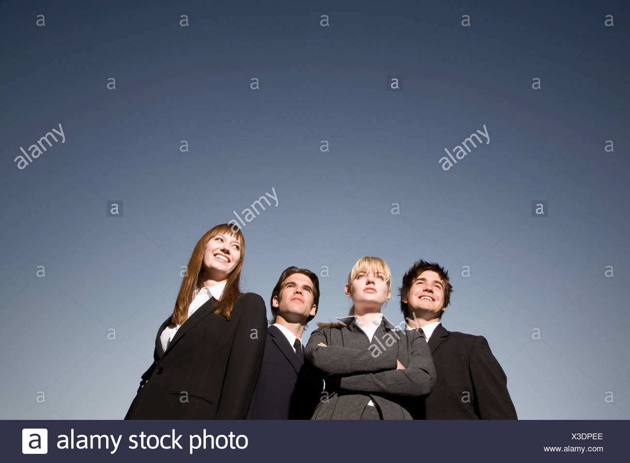 Group of businessmen and businesswomen - Stock Image