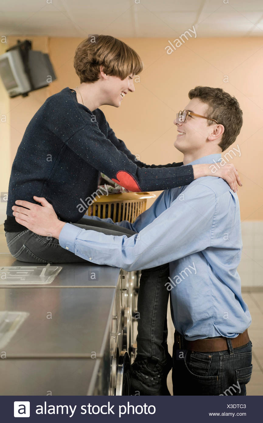 Young couple falling in love, smiling - Stock Image