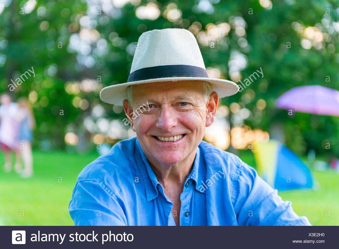 Elderly man with hat smiling, Bavaria, Germany - Stock Image