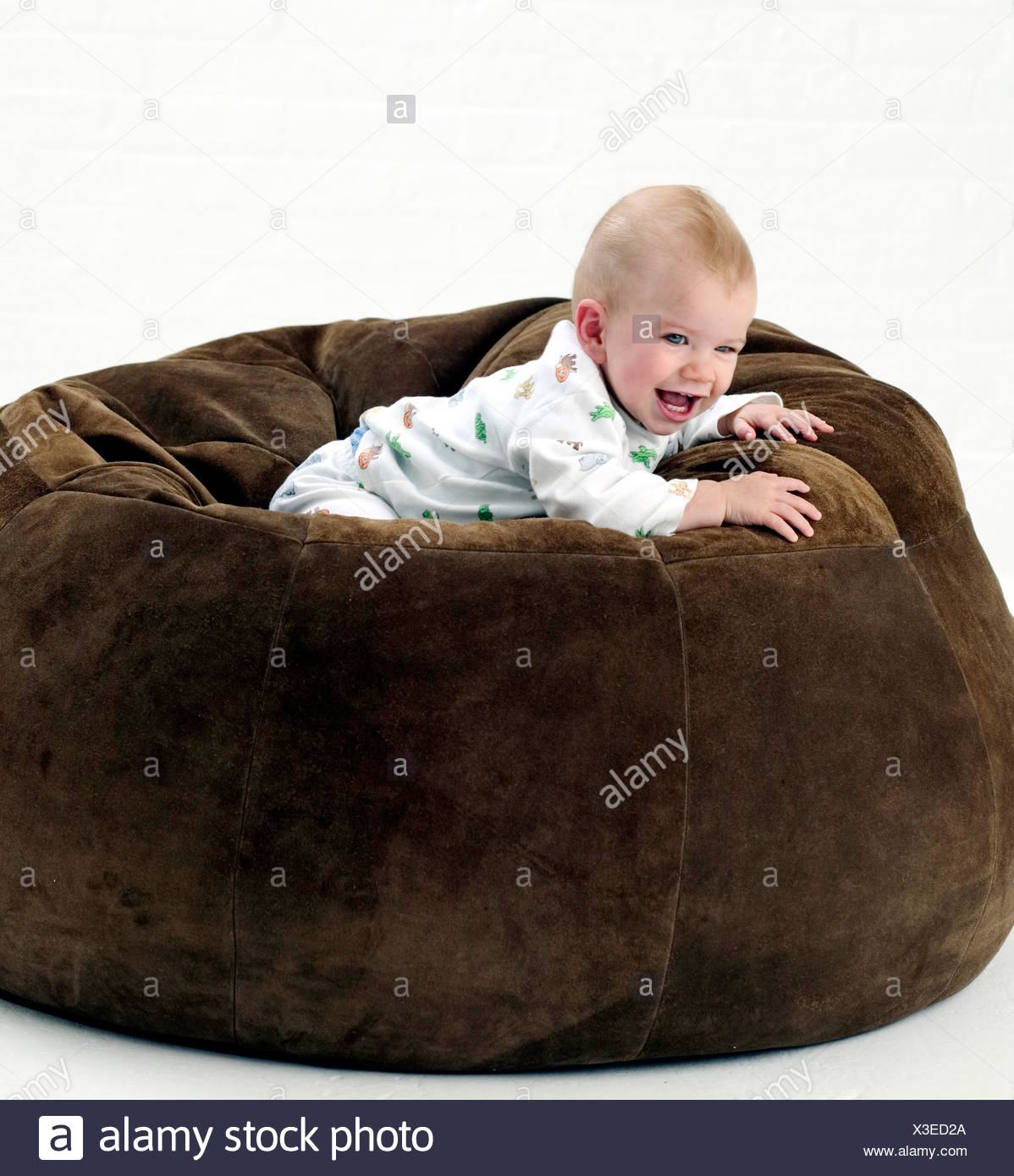Super Male Baby Wearing White Patterned Babygro Lying On Front On Dailytribune Chair Design For Home Dailytribuneorg