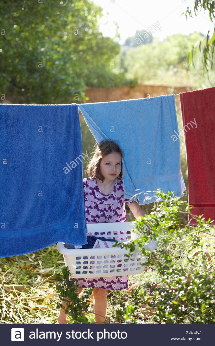 Young girl carrying the washing - Stock Image
