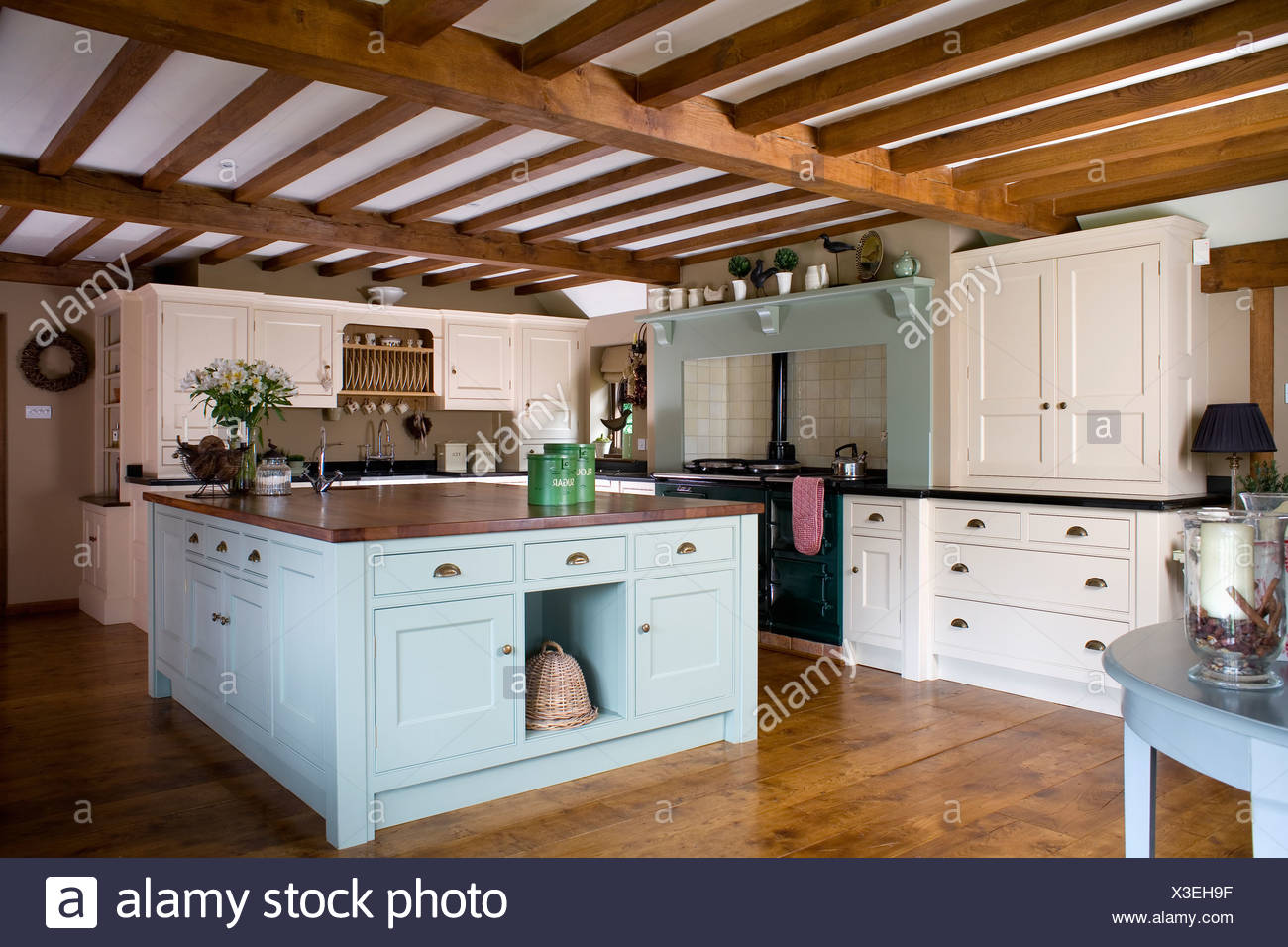 Soffitto Travi A Vista pastel blue island unit in large cream country kitchen with